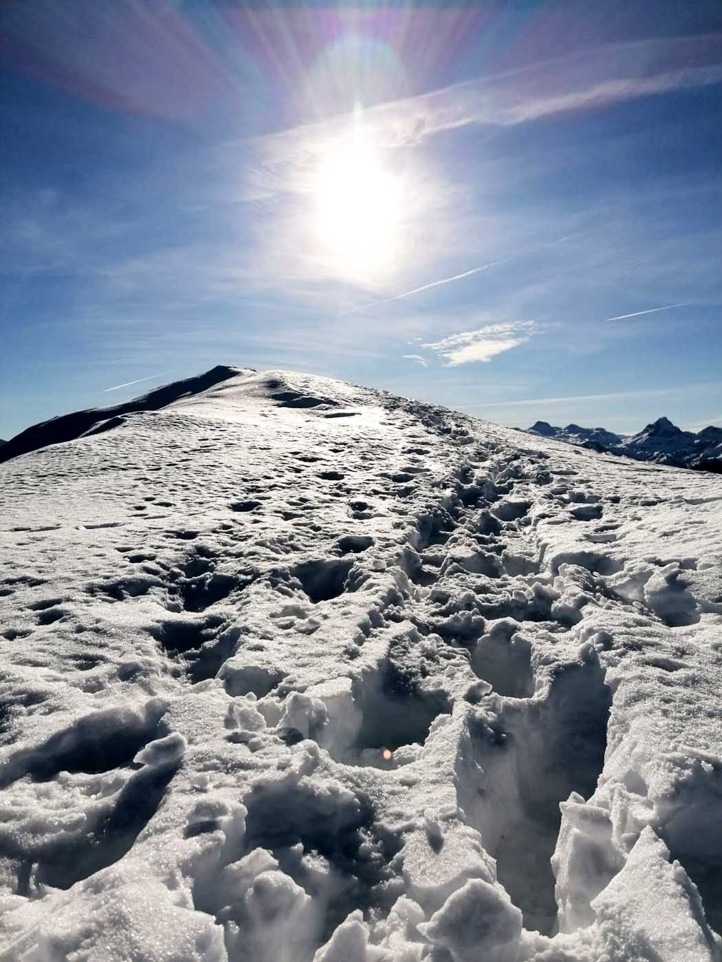 Summit happiness in winter, a dream for all mountain lovers